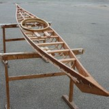 the finished frame of the Greenland kayak is made out of Western Red Cedar
