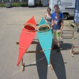 the finished kayaks with their builder